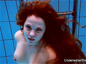 wonderful gal showcases stunning figure underwater