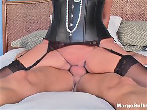 Mature Margo rides salami in a jewel necklace