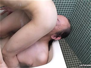 japanese cockslut in the bathtub getting her poon eaten out