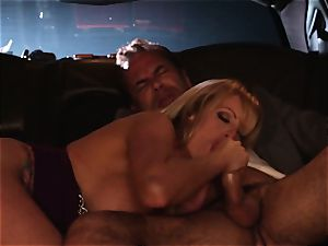 Stormy Daniels fellates off a stranger in the back seat