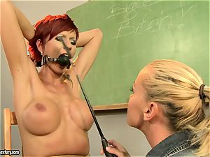 Kathia Nobili giving a kinky lesson to a hot red head